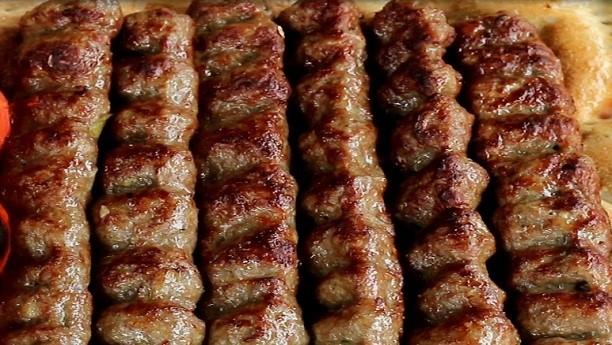 Afghan Cuisine logo